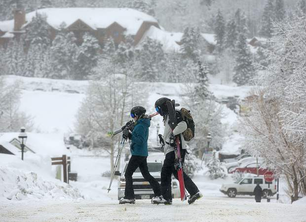 Skiers cross Wellington Road Wednesday, March 13, in Breckenridge.