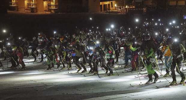 At exactly midnight Friday, participants in the Grand Traverse ski race between Crested Butte and Aspen start the 40-mile long race across the West Elk Mountains.