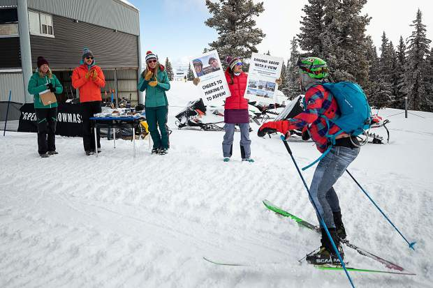 Left to right, Erin Young, Andrew Hickok, Julie Hardman, and Kathy Fry cheer on Grand Traverse racer Doug Stenclik of Carbondale at the last checkpoint of the race on top of Aspen Mountain on Saturday.