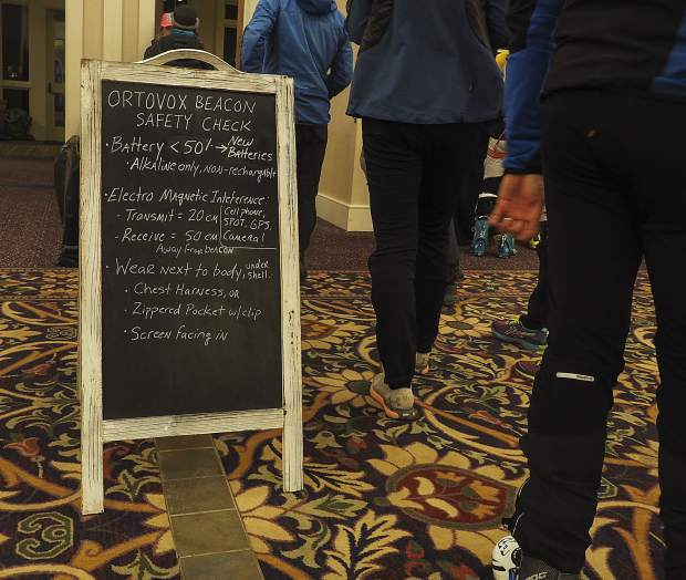 Racers line up for an avalanche beacon check in the Ballroom of the Lodge at Mountaineer Square during the mandatory pre-start beacon check and Spot distribution before the start of the Grand Traverse ski race between Crested Butte and Aspen on Friday.