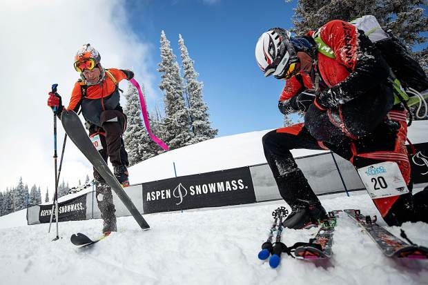 Grand Traverse team members Eric Broecker and Kurt Sorensen from Frisco transition at the last check point on Saturday at the top of Aspen Mountain.