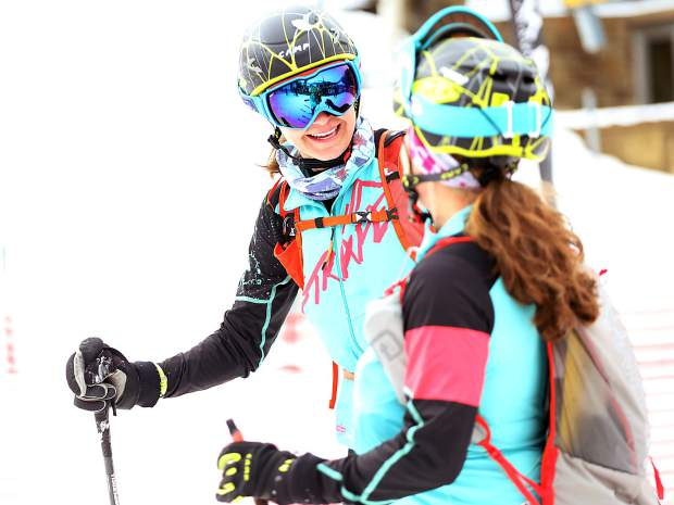 Nikki LaRochelle, left, laughs with teammate Jessie Young after completing the 2019 Audi Power of Four ski mountaineering race on Saturday, March 2, 2019, in Aspen. (Photo by Austin Colbert/The Aspen Times).