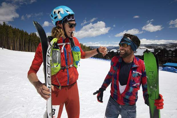 Carbondale residents and 5 Peaks ski mountaineer racing champions Paul Hamilton and Doug Stenclik share a moment at the finish line Saturday, April 27, in Breckenridge.