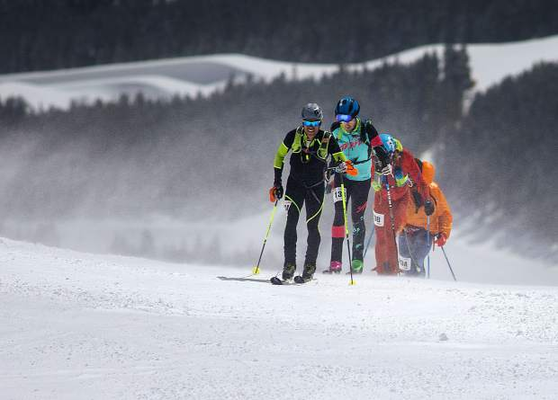 Jon Brown of Crested Butte and other racers skin up towards summit of Peak 8 during the 5 Peaks ski mountaineering race Saturday, April 27, in Breckenridge.