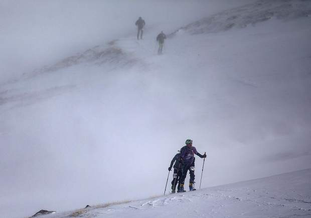 Ski mountaineering racers skin up towards Peak 10 during the 5 Peaks race Saturday, April 27, in Breckenridge.
