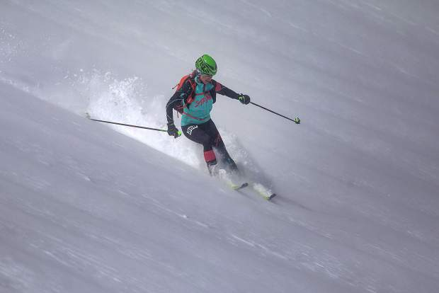 Breckenridge resident Nikki LaRochelle races down the 4th of July bowl on Peak 10 during the 5 Peaks ski mountaineering race Saturday, April 27, in Breckenridge. Strong wind gusts took away LaRochelle's sunglasses while wearing them near the summit.