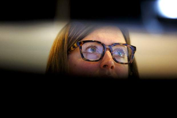 911 dispatcher Kandace Cornelsen eyes the monitors while on duty Friday, April 26, at the Summit County Communications in Frisco.