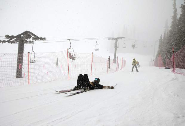 A skier participating in the 30th Annual Enduro, a fundraiser and ski-a-thon to benefit a local cause, slide towards base of Pallavicini Chair Wednesday, April 10, at Arapahoe Basin Ski Area.