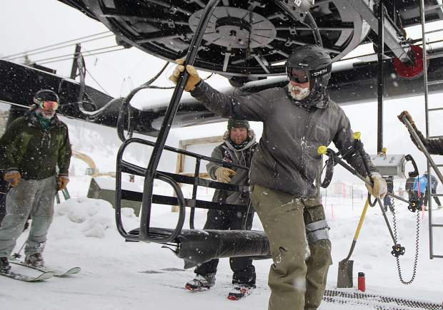 A skier participating in the 30th Annual Enduro, a fundraiser and ski-a-thon to benefit a local cause, hops on the Pallavicini Chair Wednesday, April 10, at Arapahoe Basin Ski Area.