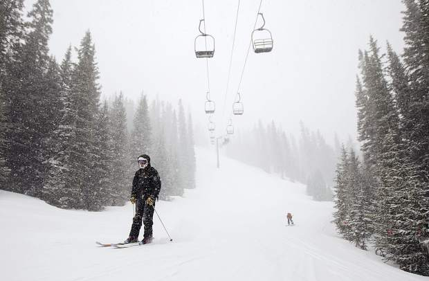 A skier participating in the 30th Annual Enduro, a fundraiser and ski-a-thon to benefit a local cause, heads towards base of Pallavicini Chair Wednesday, April 10, at Arapahoe Basin Ski Area.