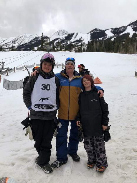 Zack Wojtalik, left, and Lucas Lemire, right, pose for a photograph with their Team Summit big mountain coach Sam Michaels during Friday's IFSA North American Junior Freeride Championships at Kicking Horse Mountain Resort in Golden, British Columbia.
