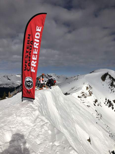 Team Summit snowboarders stand atop a ridge before dropping into big mountain terrain earlier this season.