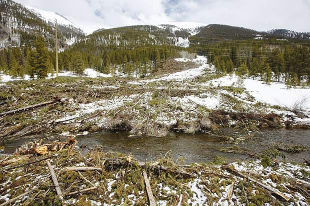 An avalanche slide path filled with debris covers the recreational path in the Tenmile Canyon Monday, April 29, near Copper Mountain.