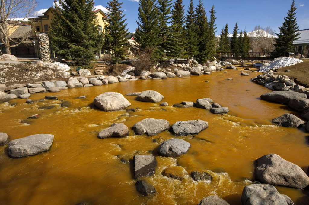 The Blue River in Breckenridge turned orange due spring runoff passing through old mines upstream Saturday afternoon, April 27. The river flows into the Dillon Reservoir, the source of water for Denver metro area.