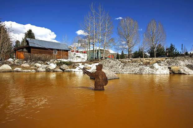 The Blue River in Breckenridge turned orange due spring runoff passing through old mines upstream on Saturday. The river flows into the Dillon Reservoir, the source of water for Denver metro area.