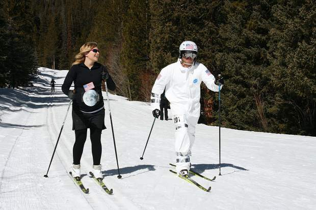 Josh Dayton, right, skis in an astronaut outfit during Sunday's 17th annual Breckebeiner 50K Nordic Ski-A-Thon fundraiser at the Breckenridge Nordic Center in Breckenridge. As a member of the team dubbled