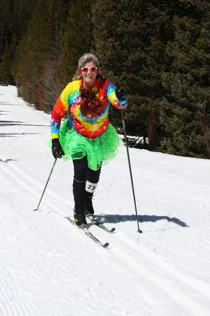 Anne Ojennes skis under bluebird skies during Sunday's 17th annual Breckebeiner 50K Nordic Ski-A-Thon at the Breckenridge Nordic Center in Breckenridge. Ojennes skied 10 kilometers for Team Tie Dye.