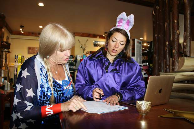 Therese Dayton of the Breckenridge Nordic Center and Breckenridge Outdoor Education Center development manager Hallie Jaeger look over paperwork at Sunday's 17th annual Breckebeiner 50K Nordic Ski-A-Thon fundraiser at the Breckenridge Nordic Center in Breckenridge. Jaeger skied five kilometers as part of the BOEC's team dubbed