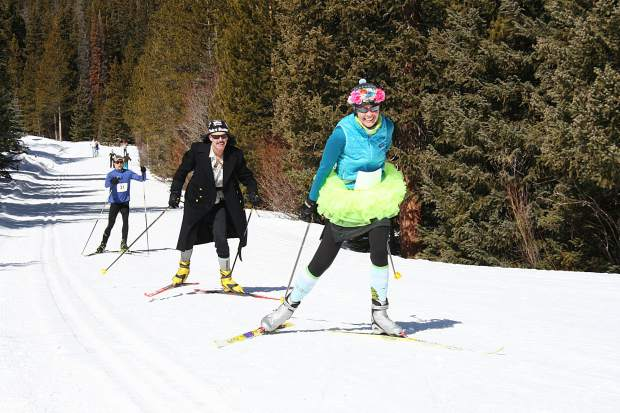 Participants skate-ski uphill toward the Breckenridge Nordic Center during Sunday's 17th annual Breckebeiner Nordic Ski-A-Thon fundraiser in Breckenridge.