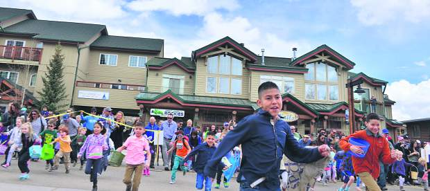 Children race off at the start of the annual Easter egg hunt Sunday in Frisco. The town blocked off Main Street and scattered 5,000 plastic eggs for the hunt that spanned Frisco Historic Park to town hall.