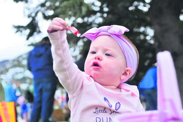 Ruby Jean Brewer, 1, of Frisco inspects the haul as she celebrates her first Easter with her family Sunday in Frisco.