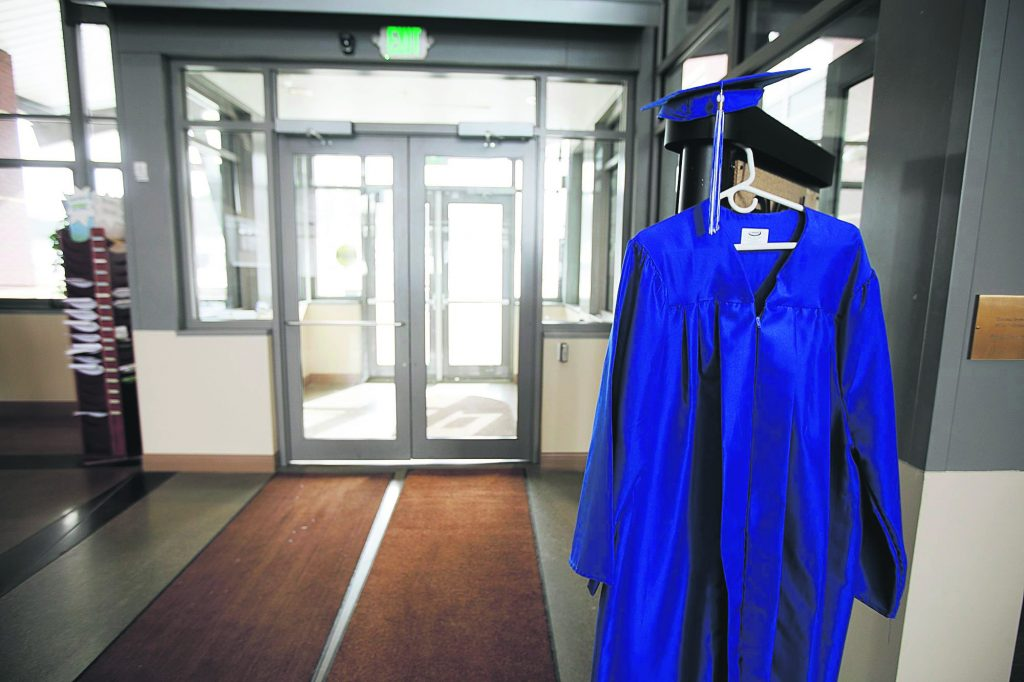 A graduation gown hangs at the entrance of Colorado Mountain College campus Thursday, April 11, in Breckenridge.