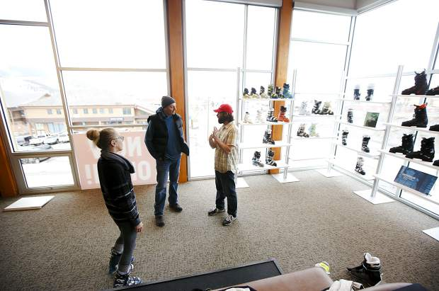Christy Sports employee Andy Turner, far right, assists customers in the ski boot section of the renovated store location in Dillon Tuesday, April 2, along Highway 6.