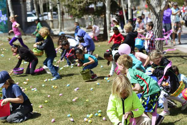 Children round up eggs during the 2017 Easter egg hunt in Frisco. The Easter Bunny will visit with children before and after the egg hunt on Main Street.