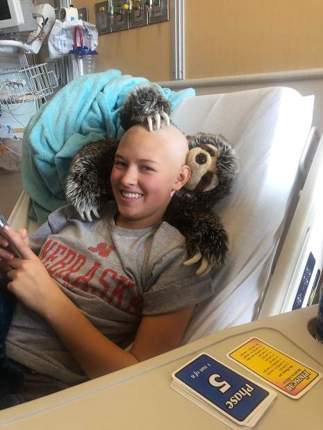 Taylor Ash, a junior student-athlete at Summit High School, is currently receiving chemotherapy as part of her treatment for her diagnosis of the rare bone cancer Osteosarcoma.