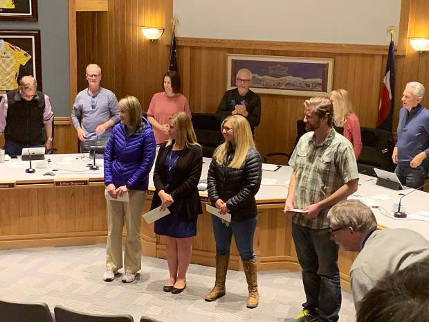 Breckenridge town employees, from left, Carmen Brashier, Kay Atteberry, Tiffany Perez and Steve Worrall get a standing ovation during Tuesday's Breckenridge Town Council meeting after receiving Everyday Leader Awards for their work on the town's AED program. Two other town employees instrumental in the effort, Howard White and Lisa Sockett, were unable to attend.
