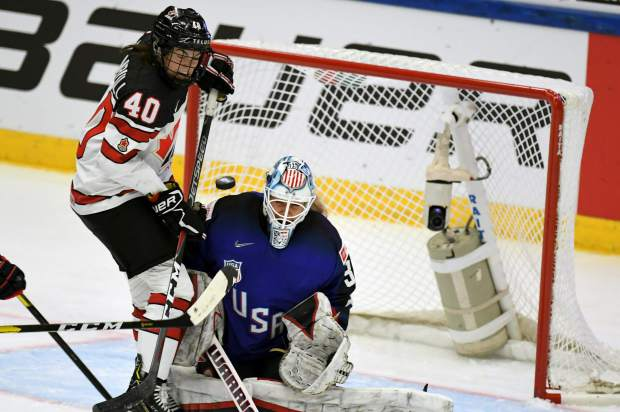 Goalie Alex Rigsby ofTeam USA and Blayre Turnbull of Canada, left, are in action during the 2019 IIHF Women's World Championships preliminary match between the USA and Canada in Espoo, Finland on Saturday.