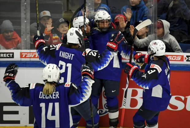 Team USA celebrates a goal during the 2019 IIHF Women's World Championships preliminary match between USA and Canada in Espoo, Finland on Saturday.