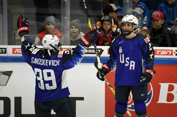 Melissa Sasmos Kevich, left, and Annie Pankowski of Team USA celebrate a goal during the 2019 IIHF Women's World Championships preliminary match between USA and Canada in Espoo, Finland on Saturday.