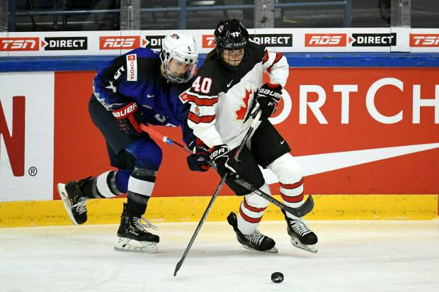 Megan Keller of Team USA, left, and Blayre Turnbull of Canada are in action during the 2019 IIHF Women's World Championships preliminary match between Team USA and Canada in Espoo, Finland on Saturday.