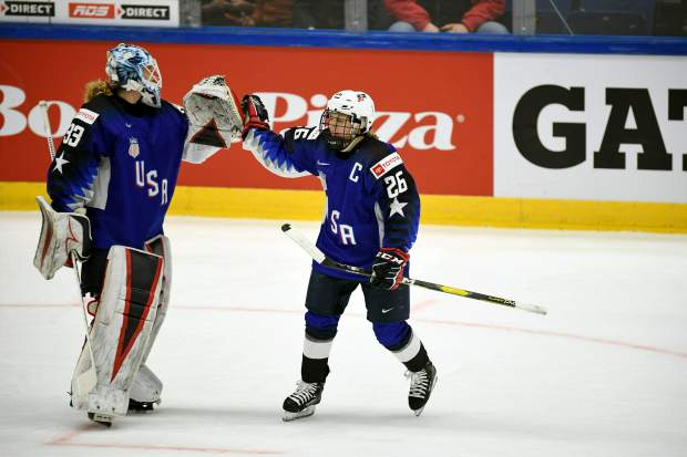 Goalie Alex Rigsby, left, and Kendall Coyne Schofield of Team USA celebrate a goal during the 2019 IIHF Women's World Championships preliminary match betweenTeam USA and Canada in Espoo, Finland on Saturday.