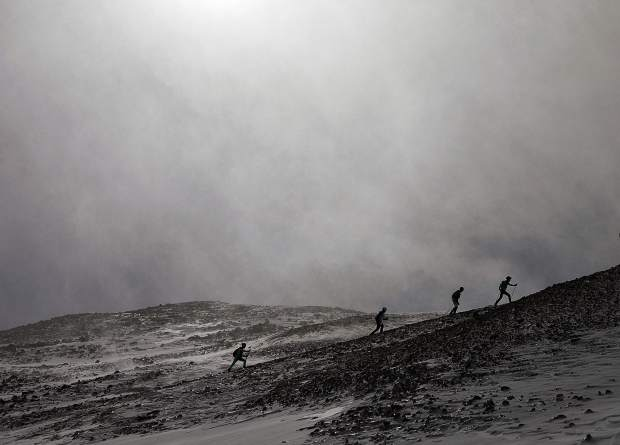 Ski mountaineering racers skin up toward Peak 10 during The Five Peaks race on Saturday, April 27, in Breckenridge.