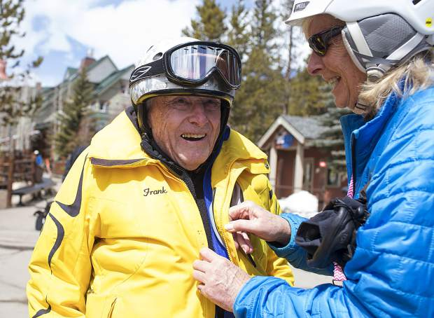 Frank Walter, 96, is buttoned up by Gini Patterson, Director of Timberline, Thursday, April 4, at Keystone Resort.
