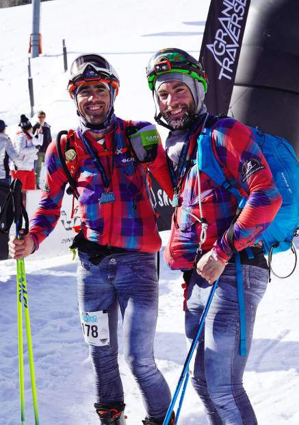 Summit Daily News staff photographer Hugh Carey, left, and Cripple Creek Backcountry owner Doug Stenclik smile at the Aspen Mountain finish line of the Grand Traverse ski mountaineering race on Saturday morning. The Grand Traverse is an annual 37.25-mile race through the Elk Mountains to Aspen that begins in Crested Butte at midnight.