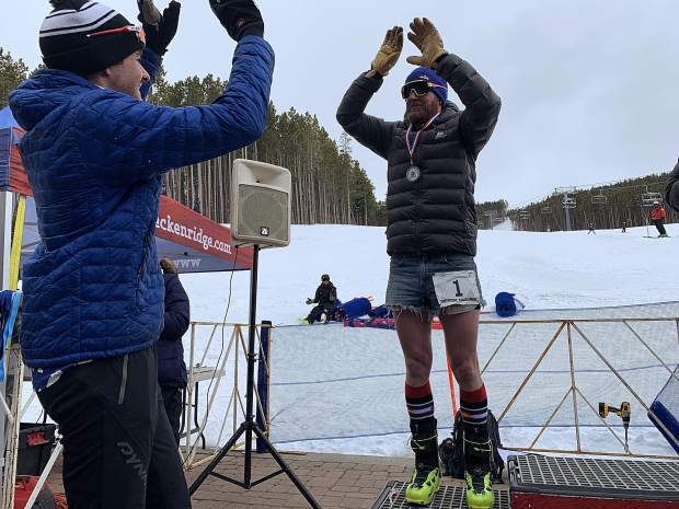 Sam O'Keefe (left) and Joe Howdyshell, both of Breckenridge, high-five each other during the podium ceremony at Saturday's Imperial Challenge at Breckenridge Ski Resort's Peak 7 base area. O'Keefe and Howdyshell finished in first and second places overall, respectively.