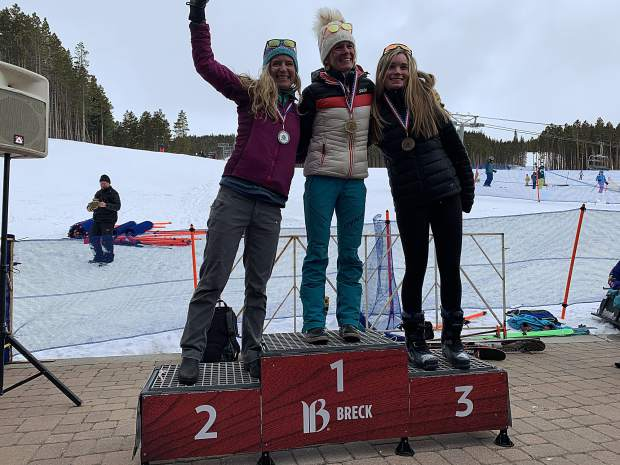 Overall women's champion Jill Sorensen (center), of Dillon, second-place finisher Marlee Dixon (left) of Fairplay and third-place finisher Elsa Bates of Breckenridge stand atop the podium for the overall women's competition at Saturday's Imperial Challenge at Breckenridge Ski Resort's Peak 7 base area.