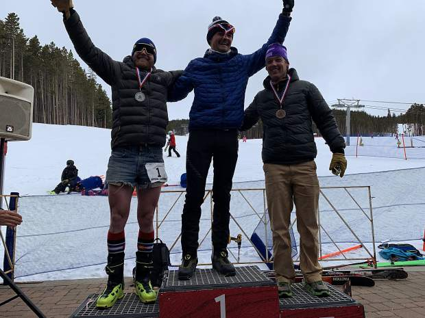 Sam O'Keefe (center) Joe Howdyshell (left) and Duke Barlow, all of Breckenridge, stand atop the podium for the overall men's competition at Saturday's Imperial Challenge at Breckenridge Ski Resort's Peak 7 base area.
