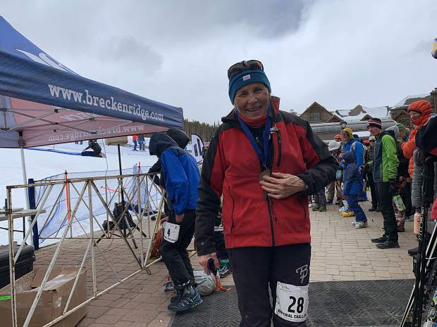 Summit County local Sharon Crawford holds her medal after completing yet another Imperial Challenge at Breckenridge Ski Resort.