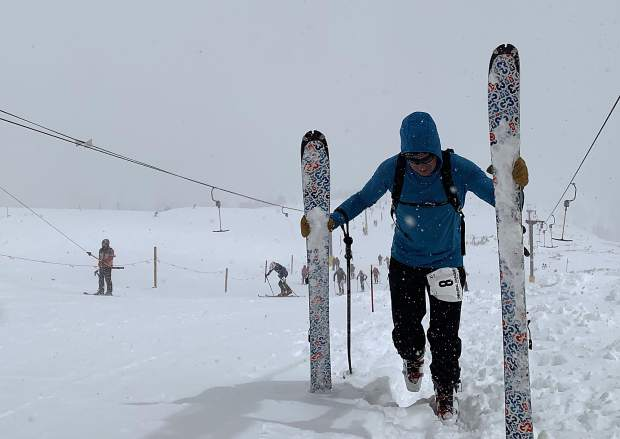 Neil Bezdek of Denver ascends up past the top of the T-bar during Saturday's Imperial Challenge at Breckenridge Ski Resort.