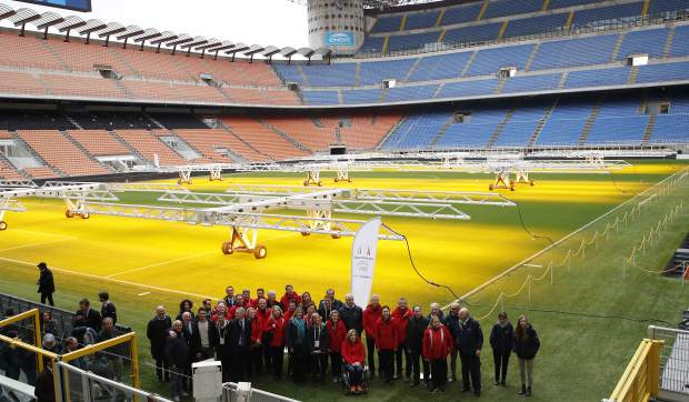 Winter Olympics Milano Cortina bid IOC Evaluation Commission poses in the San Siro stadium, in Milan, Italy on Thursday.