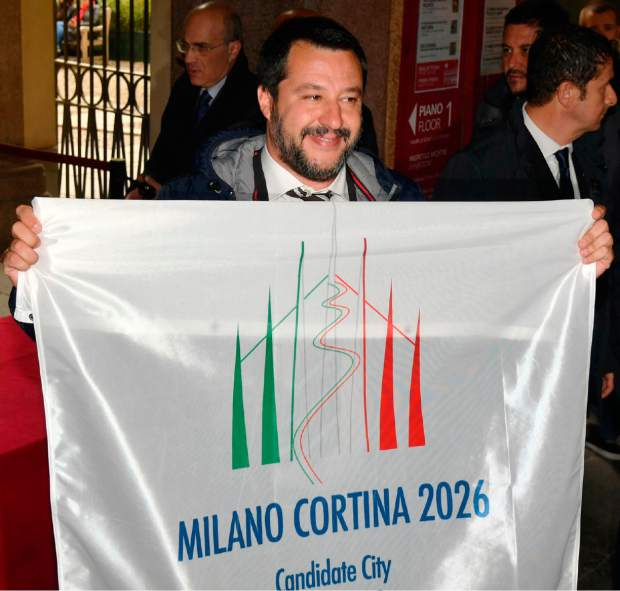 Deputy Prime Minister of Italy and Minister of Interior, Matteo Salvini, holds a Milan-Cortina 2026 Winter Olympics candidate city flag upon his arrival at a meeting with the International Olympic Committee evaluation commission, in Milan on Friday. The Milan-Cortina d'Ampezzo bid for the 2026 Winter Olympics has been boosted by a key letter of financial support from the Italian government. The letter signed by Italian Premier Giuseppe Conte was delivered to Octavian Morariu, the chair of the IOC's evaluation commission, which is concluding a weeklong inspection of the bid sites.