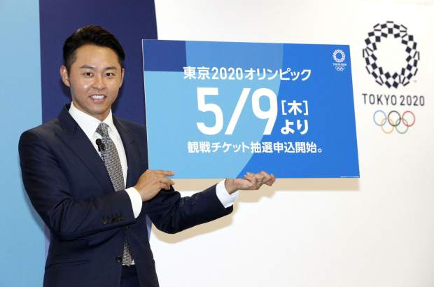 Kosuke Kitajima, a four-time Olympic swimming gold medalist attends a press conference in Tokyo on Thursday. Kitajima helped Tokyo Olympic organizers launch their ticket website on Thursday, which is where only Japan residents can buy tickets when they go on sale in Japan on May 9. But the useful site can also be accessed by people outside Japan, where basic prices are listed along with the full competition schedule.