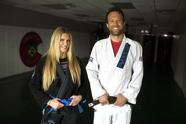Summit County Jiu Jitsu owner Douglas Cuomo (right) and gym member Asti Alexandria pose for a photograph at Summit County Jiu Jitsu on Wednesday, April 10, at the martial arts gym in Frisco.