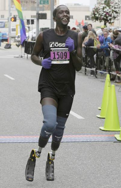 Marko Cheseto, a college All-American who lost both feet to frostbite after being stranded outside in an Alaskan blizzard in 2011, competes in the Skinny Raven Half Marathon during the Anchorage RunFest in Anchorage, Alaska in August 2018. After making his marathon debut in New York in 2018, Cheseto will run in the Boston Marathon on April 15, with the goal of competing in the race's new Para Athlete division in 2020.