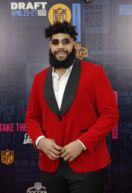 Oklahoma tackle Cody Ford walks the red carpet ahead of the first round at the NFL football draft, Thursday, April 25, 2019, in Nashville, Tenn. (AP Photo/Mark Humphrey)