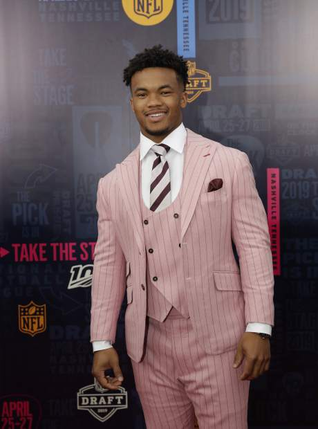 Oklahoma quarterback Kyler Murray walks the red carpet ahead of the first round at the NFL football draft, Thursday, April 25, 2019, in Nashville, Tenn. (AP Photo/Mark Humphrey)